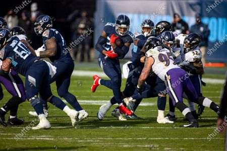 Stock Image of Tennessee Titans running back Derrick Henry (22) runs with the ball against the Baltimore Ravens during the fourth quarter of an NFL wild-card playoff football game, in Nashville, Tenn. Ravens defeat Titans 20-13