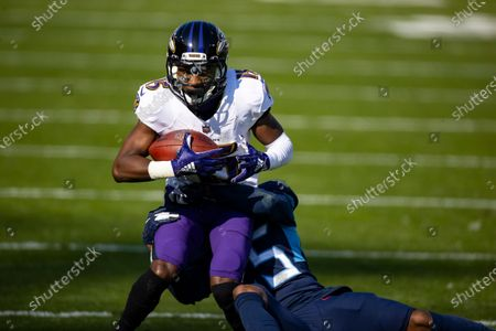 Baltimore Ravens wide receiver Marquise Brown (15) makes a first down reception against Tennessee Titans cornerback Adoree' Jackson (25) during the second quarter of an NFL wild-card playoff football game, in Nashville, Tenn. Ravens defeat Titans 20-13