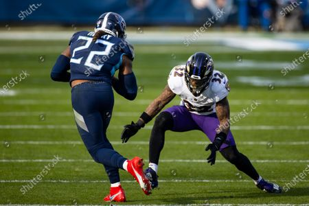 Baltimore Ravens free safety DeShon Elliott (32) lowers to tackle Tennessee Titans running back Derrick Henry (22) during the third quarter of an NFL wild-card playoff football game, in Nashville, Tenn. Ravens defeat Titans 20-13