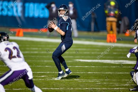 Tennessee Titans quarterback Ryan Tannehill (17) drops back to pass against the Baltimore Ravens during the first quarter of an NFL wild-card playoff football game, in Nashville, Tenn. Ravens defeat Titans 20-13