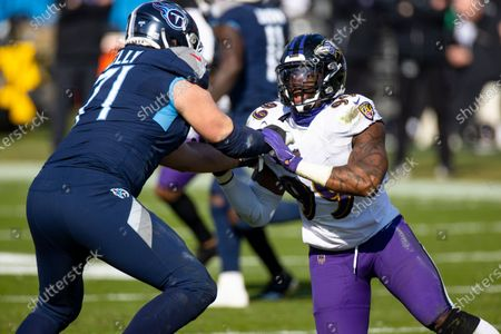 Stock Photo of Tennessee Titans offensive tackle Dennis Kelly (71) blocks as Baltimore Ravens inside linebacker Matt Judon (99) rushes during the second quarter of an NFL wild-card playoff football game, in Nashville, Tenn. Ravens defeat Titans 20-13