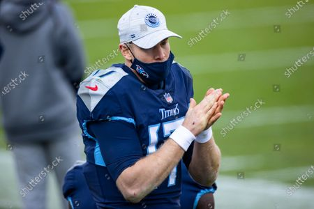 Tennessee Titans quarterback Ryan Tannehill (17) walks the sideline during the fourth quarter of an NFL wild-card playoff football game against the Baltimore Ravens, in Nashville, Tenn. Ravens defeat Titans 20-13