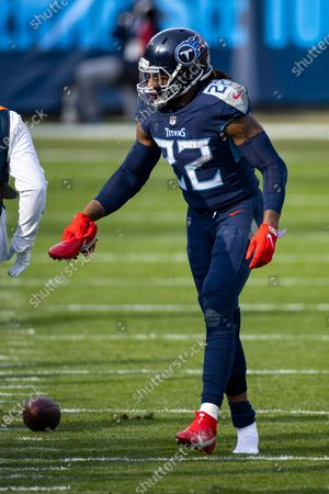 Stock Picture of Tennessee Titans running back Derrick Henry (22) gathers his shoe after a run against the Baltimore Ravens during the third quarter of an NFL wild-card playoff football game, in Nashville, Tenn. Ravens defeat Titans 20-13
