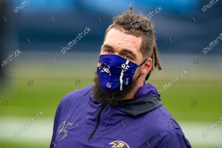 Stock Image of Baltimore Ravens defensive end Derek Wolfe (95) warms up before an NFL wild-card playoff football game against the Tennessee Titans, in Nashville, Tenn