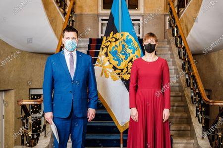 Estonian Prime Minister Juri Ratas (L) submits resignation to Estonian President Kersti Kaljulaid in Tallinn, Estonia, Jan. 13, 2021.