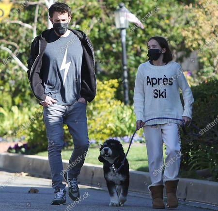 Stock Image of Ben Affleck takes daugther Seraphina Affleck for a stroll with their pet