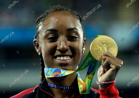 Stock Picture of Gold medal winner Brianna Rollins from the United States shows off her medal during the medal ceremony for the women's 100-meter hurdles final during the athletics competitions of the 2016 Summer Olympics at the Olympic stadium in Rio de Janeiro, Brazil. Rollins-McNeal has been provisionally suspended for a suspected doping rules violation it was reported on Thursday, Jan. 14, 2021. Rollins-McNeal won Olympic gold in the women's 100-meter hurdles for the United States at the 2016 Rio de Janeiro Games