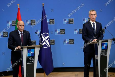 President of Mauritania Mohamed Ould Cheikh El Ghazouani (L) and North Atlantic Treaty Organization (NATO) Secretary General Jens Stoltenberg (R) give a joint press briefing after their meeting at Alliance headquarters in Brussels, Belgium, 14 January 2021.