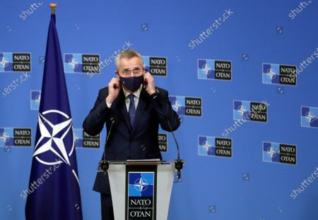 North Atlantic Treaty Organization (NATO) Secretary General Jens Stoltenberg removes his face mask as he arrives for a press briefing after a meeting with President of Mauritania Mohamed Ould Cheikh El Ghazouani at Alliance headquarters in Brussels, Belgium, 14 January 2021.