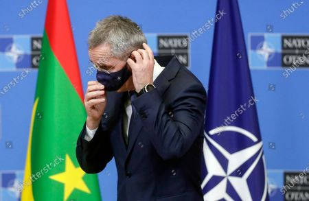 North Atlantic Treaty Organization (NATO) Secretary General Jens Stoltenberg puts a face mask on at the end of a press briefing after a meeting with President of Mauritania Mohamed Ould Cheikh El Ghazouani at Alliance headquarters in Brussels, Belgium, 14 January 2021.