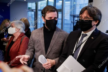 Stock Image of Former Catalan Education Minister Clara Ponsati (L), dismissed Catalan regional Minister of Health Antoni Comin (C) and Former Catalan leader Carles Puigdemont arrive at a Legal affairs committee to debate on their immunity at the European Parliament in Brussels, Belgium, 14 January 2021. The procedure was suspended for seven months due to ongoing crisis over the coronavirus disease (COVID-19) pandemic.