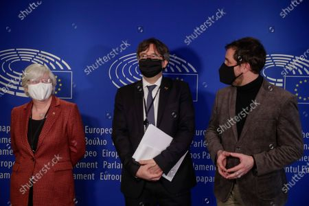 Former Catalan Education Minister Clara Ponsati (L), dismissed Catalan regional Minister of Health Antoni Comin (R) and Former Catalan leader Carles Puigdemont (C) arrive at a legal affairs committee to debate on their immunity at the European Parliament in Brussels, Belgium, 14 January 2021. The procedure was suspended for seven months due to ongoing crisis over the coronavirus disease (COVID-19) pandemic.