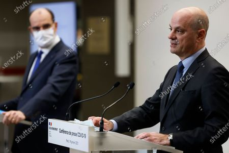French Education, Youth and Sports Minister Jean-Michel Blanquer (R) speaks flanked by French Prime Minister Jean Castex during a press conference in Paris, France 14 January 2021, on the current French government's strategy for the ongoing coronavirus (COVID-19) pandemic.