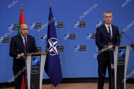 Stock Picture of Mauritania's President Mohamed Ould El-Ghzaouani, left, speaks during a joint press conference with NATO Secretary General Jens Stoltenberg at the NATO headquarters in Brussels