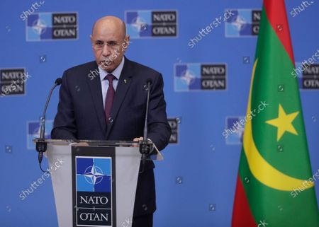 Mauritania's President Mohamed Ould El-Ghzaouani speaks during a joint press conference with NATO Secretary General Jens Stoltenberg at the NATO headquarters in Brussels