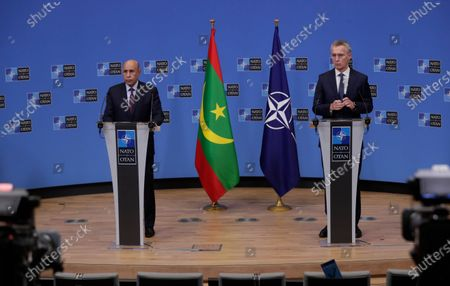 Stock Image of Mauritania's President Mohamed Ould El-Ghzaouani, left, speaks during a joint press conference with NATO Secretary General Jens Stoltenberg at the NATO headquarters in Brussels