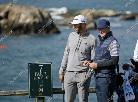 Dustin Johnson, left, and Wayne Gretzky stand on the seventh tee of the Pebble Beach Golf Links during the third round of the AT&T Pebble Beach Pro-Am golf tournament, in Pebble Beach, Calif. The Feb. 11-14 tournament will not have celebrities for the first time because of the COVID-19 pandemic