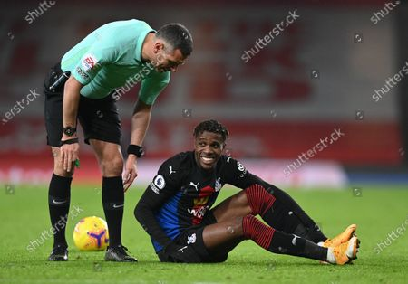 Wilfried Zaha of Crystal Palace (R) speaks to referee Andre Andre Marriner during the English Premier League soccer match between Arsenal FC and Crystal Palace in London, Britain, 14 January 2021.