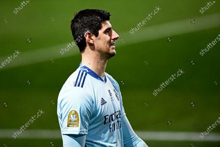 Stock Photo of Real Madrid's goalkeeper Thibaut Courtois leaves the pitch at the end of the Spanish Super Cup semi final soccer match between Real Madrid and Athletic Bilbao at La Rosaleda stadium in Malaga, Spain, . Athletic Bilbao won 2-1 and will play the final