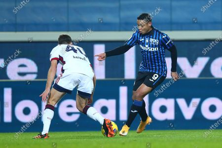 Atalanta's Luis Muriel (R) and Cagliari's Sebastian Walukiewicz in action during the Italian Cup round of sixteen soccer match between Atalanta BC and Cagliari at the Gewiss Stadium in Bergamo, Italy, 14 January 2021.