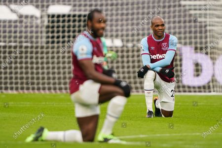 Angelo Ogbonna of West Ham United takes a knee in support of the Black Lives Matter campaign