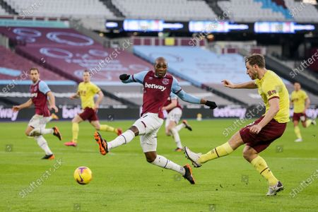 Angelo Ogbonna of West Ham United attempts to block the cross of Chris Wood of Burnley