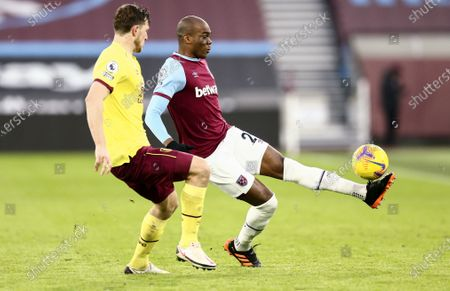 Angelo Ogbonna of West Ham United gets the ball over Chris Wood of Burnley