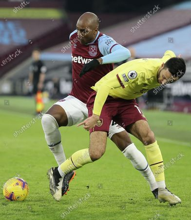 Angelo Ogbonna of West Ham United battles with Dwight McNeil of Burnley