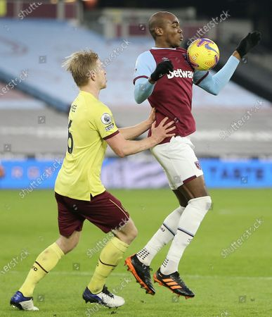 Angelo Ogbonna of West Ham United controls the ball under pressure from Ben Mee of Burnley