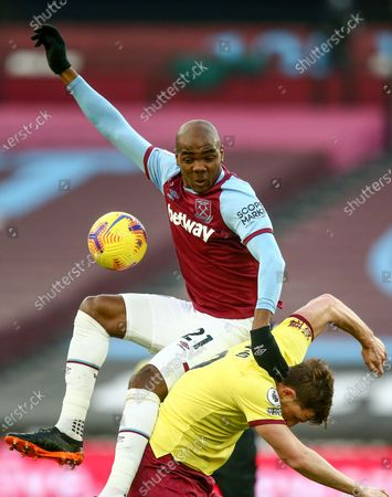 Angelo Ogbonna of West Ham United collides with Chris Wood of Burnley