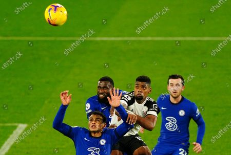 Stock Picture of Ivan Cavaleiro of Fulham battles in the air with Thiago Silva and Antonio Rudiger of Chelsea