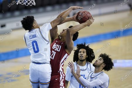 Guard Jaylen Clark (0) defends against Washington State center Dishon Jackson (21) during the first half of an NCAA college basketball game, in Los Angeles