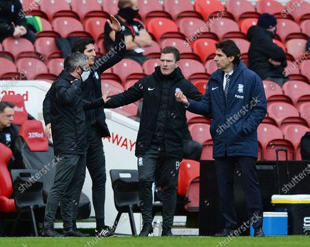 Assistant Craig Gardner and Aitor Karanka manager of Birmingham City appeals for a decision from the fourth official