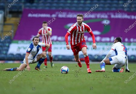 Nick Powell of Stoke City leaves Lewis Travis of Blackburn Rovers and Ryan Nyambe of Blackburn Rovers in his wake