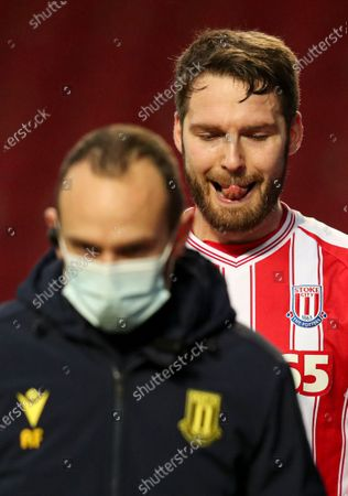 Nick Powell of Stoke City leaves the field an injury