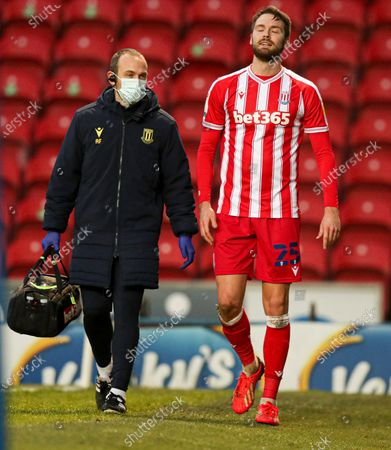 Nick Powell of Stoke City leaves the field with an injury