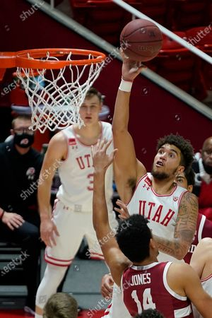 Utah forward Timmy Allen (1) shoots as Stanford forward Spencer Jones (14) defends in the second half during an NCAA college basketball game, in Salt Lake City