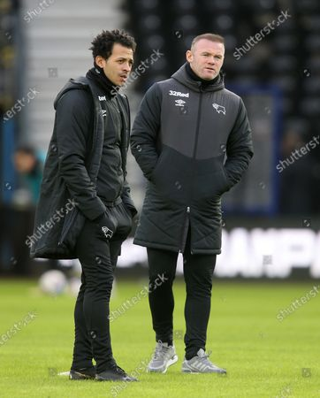 Derby County manager Wayne Rooney and assistant Liam Rosenior