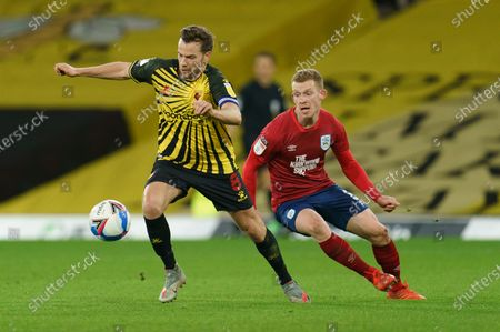 Tom Cleverley of Watford (8) and Lewis O'Brien of Huddersfield Town (8)