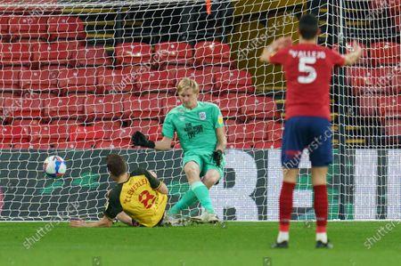 Tom Cleverley of Watford (8) scores a goal past Huddersfield Town Goalkeeper Ryan Schofield (31), 1-0