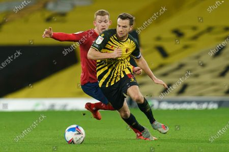 Stock Image of Lewis O'Brien of Huddersfield Town (8) and Tom Cleverley of Watford (8)