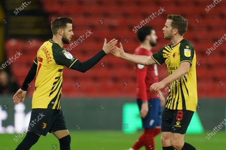 Stock Picture of Tom Cleverley of Watford (8) high-fives Philip Zinckernagel of Watford (7)
