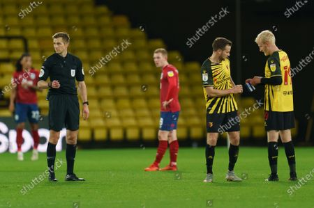 Tom Cleverley of Watford (8) hands the captains rmband to Will Hughes of Watford (19)