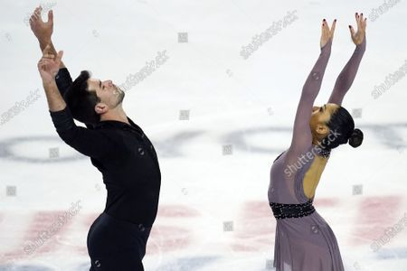 Jessica Calalang, right, and Brian Johnson perform during the pairs short program at the U.S. Figure Skating Championships, in Las Vegas