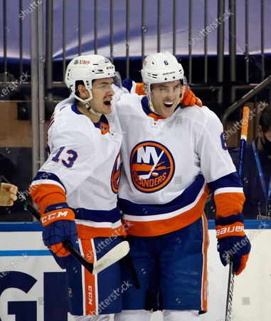 New York Islanders' Mathew Barzal, left, celebrates his first-period goal against the New York Rangers with Ryan Pulock during an NHL hockey game, in New York