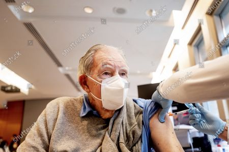 Ken Towns receives a first dose of Pfizer-BioNTech COVID-19 vaccine from UC Davis Health in Sacramento, Calif. With demand for the coronavirus vaccine vastly outpacing supply in California, efforts to methodically plan who gets a vaccine when are quickly being thrown out the window