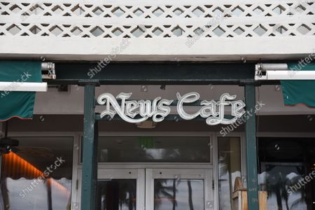 Stock Photo of A general view of the News Cafe, which opened more than thirty years ago and a favorite breakfast spot of Gianni Versace's has temporarily closed. A post on their Instagram says they're closed, temporarily. Covid numbers in the State of Florida have spiked to over 13,000 daily cases and the number of deaths has risen to 23,395 in the State of Florida.