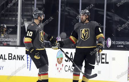 Stock Image of Vegas Golden Knights center Nicolas Roy (10) congratulates right wing Alex Tuch (89) after his empty-net goal against the Anaheim Ducks during the third period of an NHL hockey game, in Las Vegas