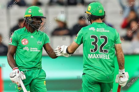 Andre Fletcher of the Melbourne Stars (left) and Glenn Maxwell of the Melbourne Stars celebrate a boundary during the Melbourne Stars vs Adelaide Strikers T20 Big Bash league match at Melbourne Cricket Ground, Melbourne