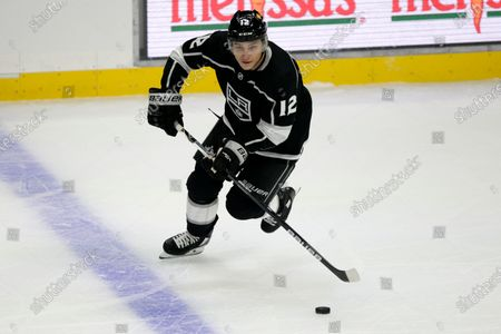 Stock Photo of Los Angeles Kings center Trevor Moore controls the puck against the Minnesota Wild during the first period of an NHL hockey game in Los Angeles